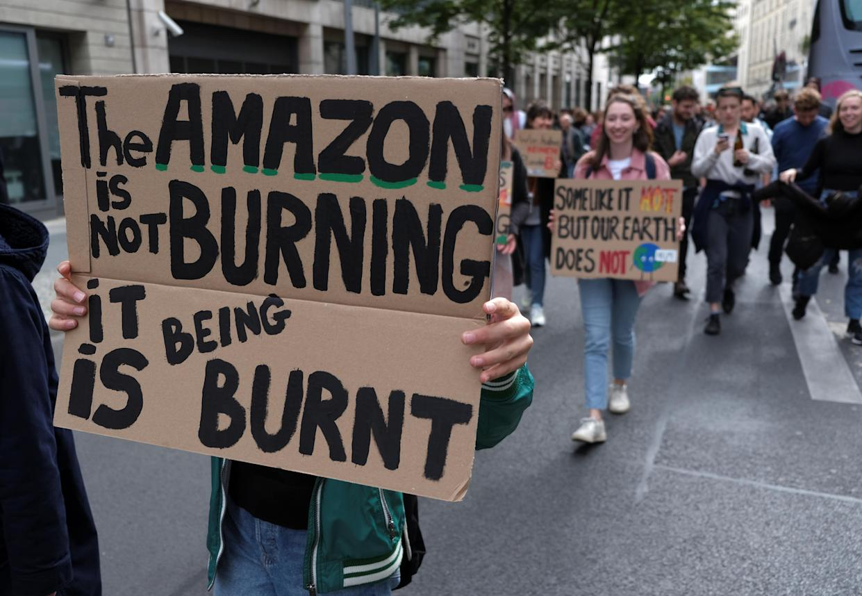 """A placard reads """"The Amazon is not burning - it is being burnt"""" during the Global Climate Strike of the movement Fridays for Future in Berlin, Germany, September 20, 2019. (Photo: Wolfgang Rattay/Reuters)"""