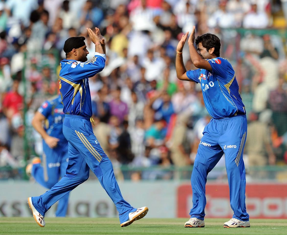 Mumbai Indians bowler R.P. Singh (R) celebrates the wicket of Kings XI Punjab  batsman Mandeep Singh with Captain Harbhajan Singh (L) during the IPL Twenty20 cricket match between Kings XI Punjab and Mumbai Indians at PCA Stadium in Mohali on April 25, 2012.  RESTRICTED TO EDITORIAL USE. MOBILE USE WITHIN NEWS PACKAGE    AFP PHOTO/ Prakash SINGH (Photo credit should read PRAKASH SINGH/AFP/Getty Images)