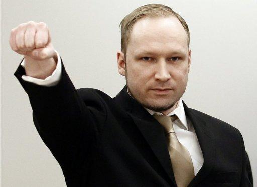 Rightwing extremist Anders Behring Breivik, who killed 77 people in twin attacks in Norway last year, makes a farright salute as he enters the Oslo district courtroom at the opening of his trial