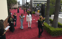 Regina King, left, and Aldis Hodge arrive at the Oscars on Sunday, April 25, 2021, at Union Station in Los Angeles. (AP Photo/Mark Terrill, Pool)
