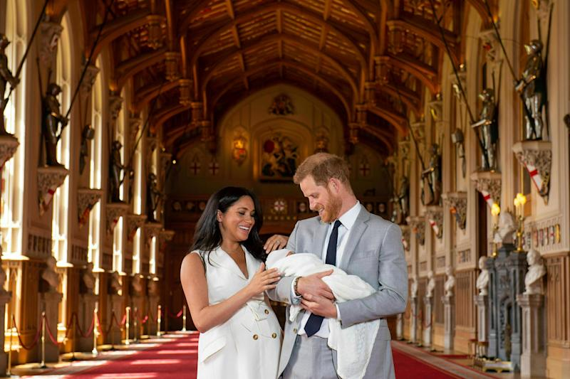 "Britain's Prince Harry and Meghan, Duchess of Sussex, during a photocall with their newborn son, in St George's Hall at Windsor Castle, Windsor, south England, Wednesday May 8, 2019. Baby Sussex was born Monday at 5:26 a.m. (0426 GMT; 12:26 a.m. EDT) at an as-yet-undisclosed location. An overjoyed Harry said he and Meghan are ""thinking"" about names. (Dominic Lipinski/Pool via AP)"