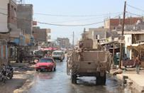 Forces loyal to the Saudi-backed Yemeni president patrol a street in the southern city of Lahj on April 24, 2016 during an operation to drive Al-Qaeda fighters out of the southern provinces (AFP Photo/Saleh Al-Obeidi)