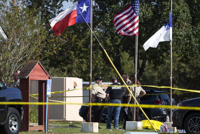 <p>Law enforcement officials stand next to a covered body at the scene of a fatal shooting at the First Baptist Church in Sutherland Springs, Texas, Nov. 5, 2017. (Nick Wagner/Austin American-Statesman via AP) </p>