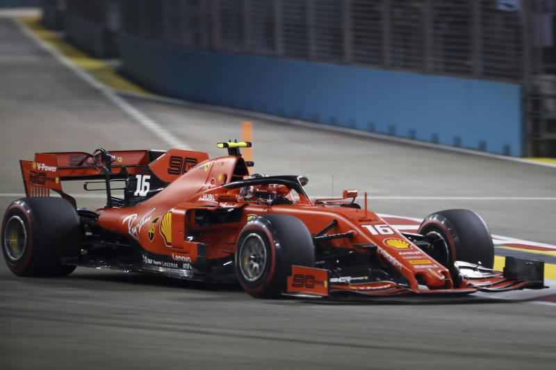Ferrari driver Charles Leclerc of Monaco steers his car during the qualifying round for the Singapore Formula One Grand Prix at the Marina Bay City Circuit in Singapore, Saturday, Sept. 21, 2019. (AP Photo/Vincent Thian)