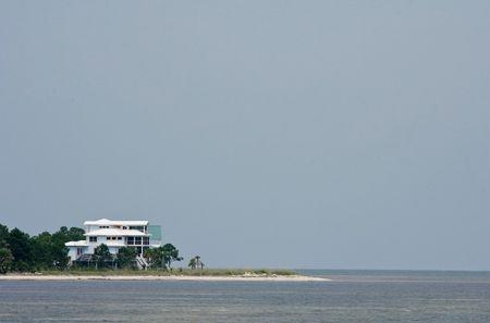A lone beachfront house sits on a point on the Gulf Coast in Carrabelle, Florida, July 9, 2014. Picture taken July 9. 2014. REUTERS/Phil Sears