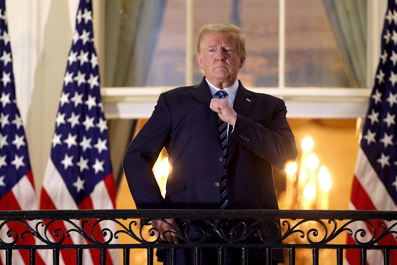 Evita: President Donald Trump gestures on the Truman Balcony after returning to the White House from Walter Reed National Military Medical Center on October 5