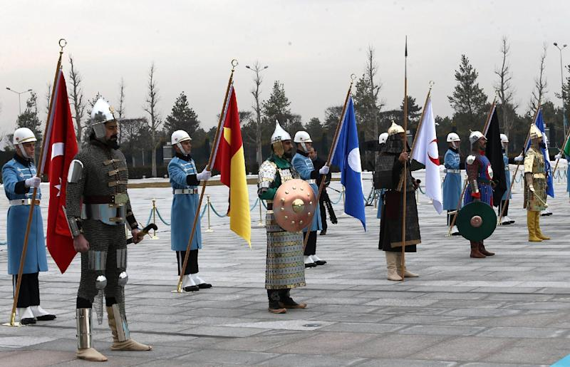 Soldiers in 16 former Turkish States' military uniforms are seen before Turkish President Recep Tayyip Erdogan welcomes Azerbaijani President Ilham Aliyev at the Presidential Palace in Ankara, on January 15, 2015 (AFP Photo/Adem Altan)
