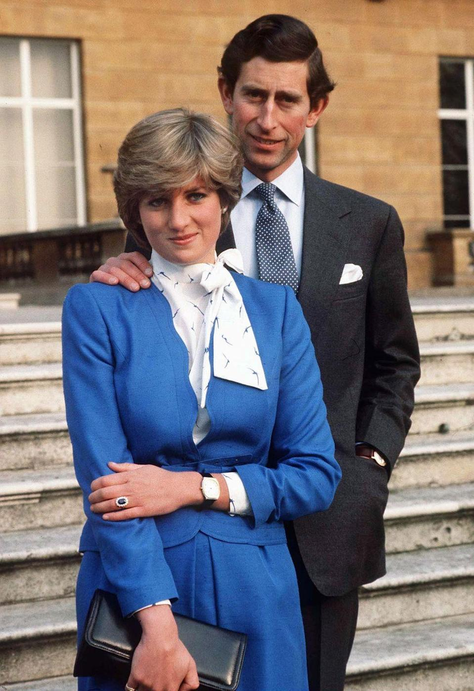 """<p>When the engagement was formally announced, this famous photo of Diana and Charles on the grounds of <a href=""""https://buckinghampalace.co.uk"""" rel=""""nofollow noopener"""" target=""""_blank"""" data-ylk=""""slk:Buckingham Palace"""" class=""""link rapid-noclick-resp"""">Buckingham Palace</a> was released. It's obvious by her somewhat awkward body language that she wasn't all that comfortable in the spotlight.</p>"""