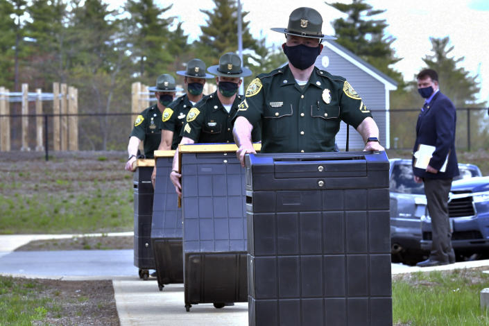 FILE - In this May 11, 2021 file photo, N.H. State Troopers deliver ballot counting machine bases to a National Guard Training area in Pembroke, N.H., which is the site of a forensic audit of a New Hampshire legislative election. Auditors concluded in a report released Tuesday, July 13, 2021, that miscounts in a New Hampshire election were caused by the way ballots were folded. (AP Photo/Josh Reynolds, File)