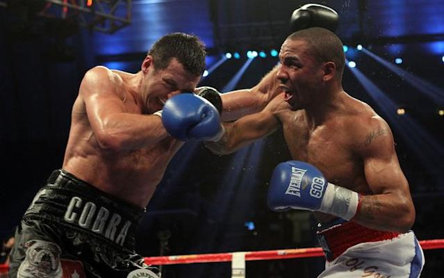 ATLANTIC CITY, NJ - DECEMBER 17: Andre Ward lands a right on Carl Froch of England during their WBA/WBC Super Middleweight Championship bout at Boardwalk Hall on December 17, 2011 in Atlantic City, New Jersey. (Photo by Nick Laham/Getty Images)