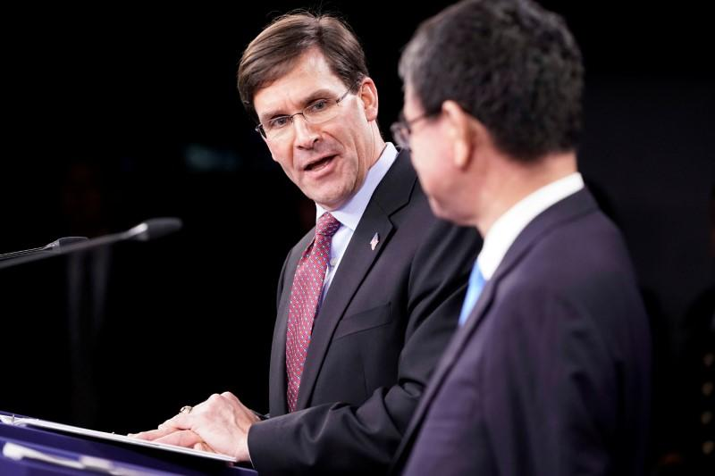 U.S. Secretary of Defense Mark Esper speaks next to Japan's Defense Minister Taro Kono during a joint news conference at the Pentagon in Washington
