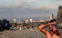 A man reacts at the scene of the explosion at the port in Lebanon's capital Beirut on August 4, 2021