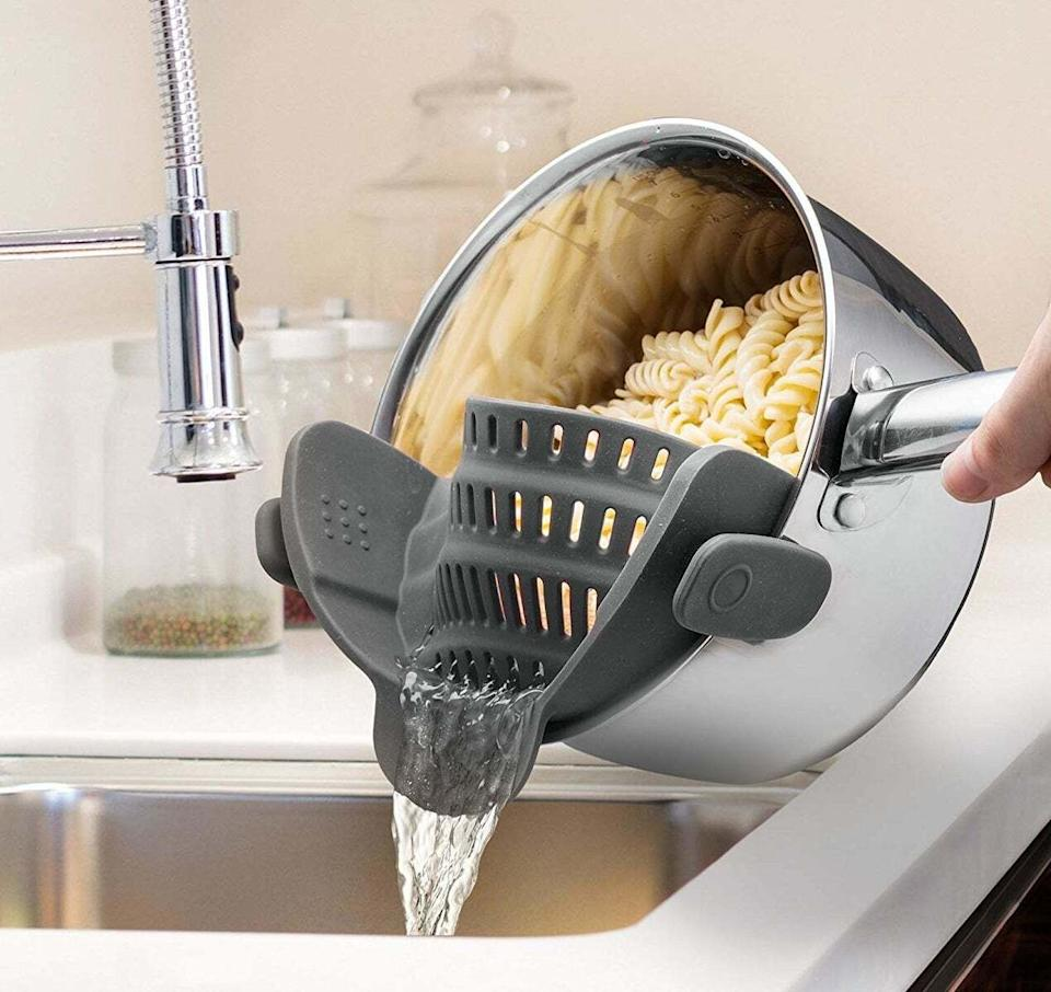"""Attaches this to the side of your pot, and you'll never burn yourself while awkwardly straining into a colander ever again! It's made of flexible silicone and designed to fit most pots and pans.<br /><br /><strong>Promising review:</strong>""""Gone are the days of pouring into a separate strainer and then having to clean two different things for a simple bowl of cooked pasta. I'm not typically a raving fan of seemingly simple kitchen gadgets, but this handy little helper works exactly as advertised. Made of hearty silicon material, it's flexible enough to snap onto all of my pots, from my small 8"""" to my largest Dutch oven.<strong>Even better, the material doesn't conduct heat so I don't have to worry about burning my hands when pulling it off the pot after it's finished draining boiling hot water.</strong>I've even left it clipped onto a pot for a little while before draining the water off, and it shows no sign of melting or marring. This is a fantastic way to shave off a few precious seconds from the process and I'd highly recommend it."""" —<a href=""""https://www.amazon.com/dp/B018W9JII0?tag=huffpost-bfsyndication-20&ascsubtag=5833640%2C40%2C43%2Cd%2C0%2C0%2C0%2C962%3A1%3B901%3A2%3B900%3A2%3B974%3A3%3B975%3A2%3B982%3A2%2C16261710%2C0"""" target=""""_blank"""" rel=""""noopener noreferrer"""">J. Im<br /></a><br /><strong>Get it from Amazon for<a href=""""https://www.amazon.com/dp/B018W9JII0?tag=huffpost-bfsyndication-20&ascsubtag=5833640%2C40%2C43%2Cd%2C0%2C0%2C0%2C962%3A1%3B901%3A2%3B900%3A2%3B974%3A3%3B975%3A2%3B982%3A2%2C16261710%2C0"""" target=""""_blank"""" rel=""""noopener noreferrer"""">$15.99+</a>(available in five colors).</strong>"""