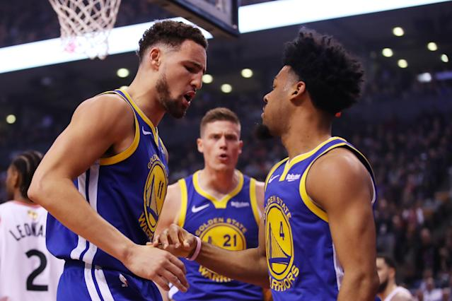 Klay Thompson #11 and Quinn Cook #4 of the Golden State Warriors celebrate the play against the Toronto Raptors in the second quarter during Game One of the 2019 NBA Finals at Scotiabank Arena on May 30, 2019 in Toronto, Canada. (Photo by Gregory Shamus/Getty Images)