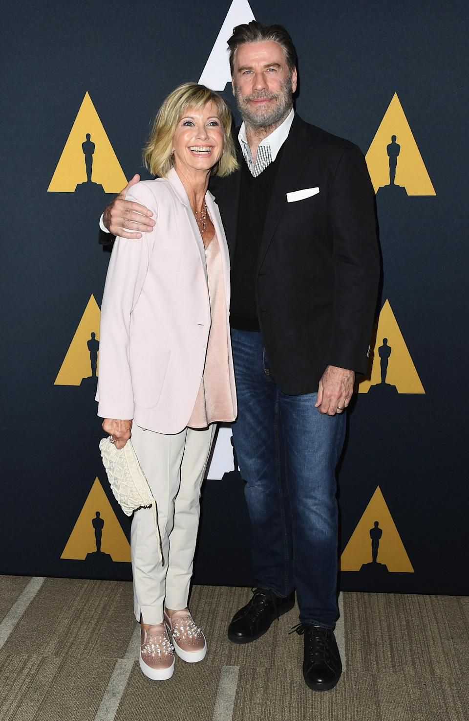 <p>The pair donned their finest smart-casual attire for their rendevous in California, with Olivia in a pale pink ensemble and John wearing jeans and a jacket. <em>[Photo: Getty]</em> </p>