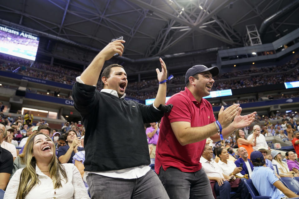 Fans cheer Jenson Brooksby, of the United States, in his match against Novak Djokovic, of Serbia, during the fourth round of the U.S. Open tennis championships, Monday, Sept. 6, 2021, in New York. (AP Photo/John Minchillo)