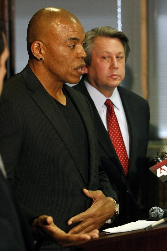 Former Kansas City Chiefs linebacker Chris Martin, left, talks about injuries suffered during his football career as he and his attorney Ken McClain, right talk about their lawsuit filed today against the Kansas City Chiefs organization during a news conference in Independence, Mo, Tuesday, Dec. 3, 2013. The lawsuit on behalf of five former Kansas City Chiefs players on the team between 1987 and 1992 was filed because the team failed to disclose the dangers of competing after suffering head injuries. (AP Photo/Colin E Braley)