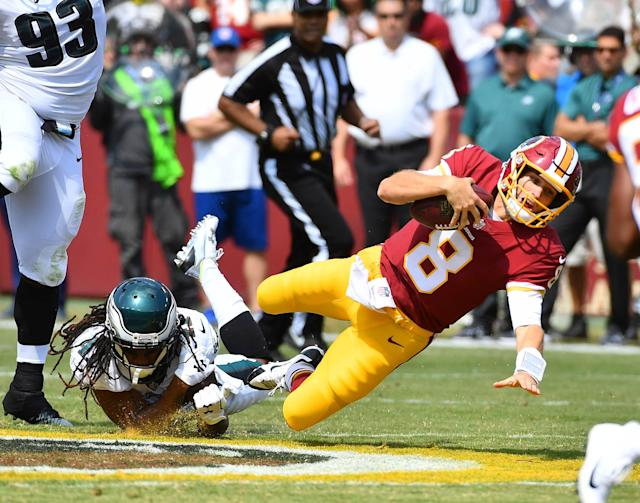 <p>Washington Redskins quarterback Kirk Cousins (8) is tackled by Philadelphia Eagles cornerback Ronald Darby (41) during the first half at FedEx Field. Mandatory Credit: Brad Mills-USA TODAY Sports </p>
