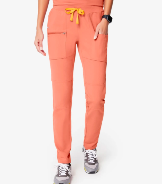 "<h2>Figs Yona Scrub Pants</h2> <br><a href=""https://www.refinery29.com/en-us/figs-scrubs"" rel=""nofollow noopener"" target=""_blank"" data-ylk=""slk:Nurses have to wear scrubs all day"" class=""link rapid-noclick-resp"">Nurses have to wear scrubs all day</a>, every day — it is the uniform, after all — so gifting them a bright new set might just be a good idea. <br><br><strong>Figs</strong> Scrub Pants, $, available at <a href=""https://go.skimresources.com/?id=30283X879131&url=https%3A%2F%2Fwww.wearfigs.com%2Fpages%2Fshop-products%2Fwomens-yona-jogger-scrub-pants-coral"" rel=""nofollow noopener"" target=""_blank"" data-ylk=""slk:Figs"" class=""link rapid-noclick-resp"">Figs</a><br>"