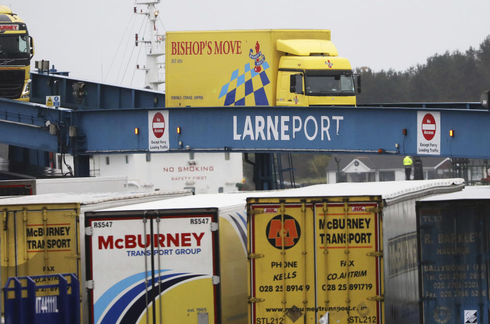 FILE - In this file photo dated Tuesday, Feb. 2, 2021, vehicles disembark from a ferry arriving from Scotland at the port of Larne, Northern Ireland. Outlawed Loyalist paramilitary groups in Northern Ireland have written to Britain's prime minister Thursday March 4, 2021, saying they are temporarily withdrawing their support for the historic 1998 peace accord because of disruption caused by new post-Brexit trade rules. (AP Photo/Peter Morrison, FILE)