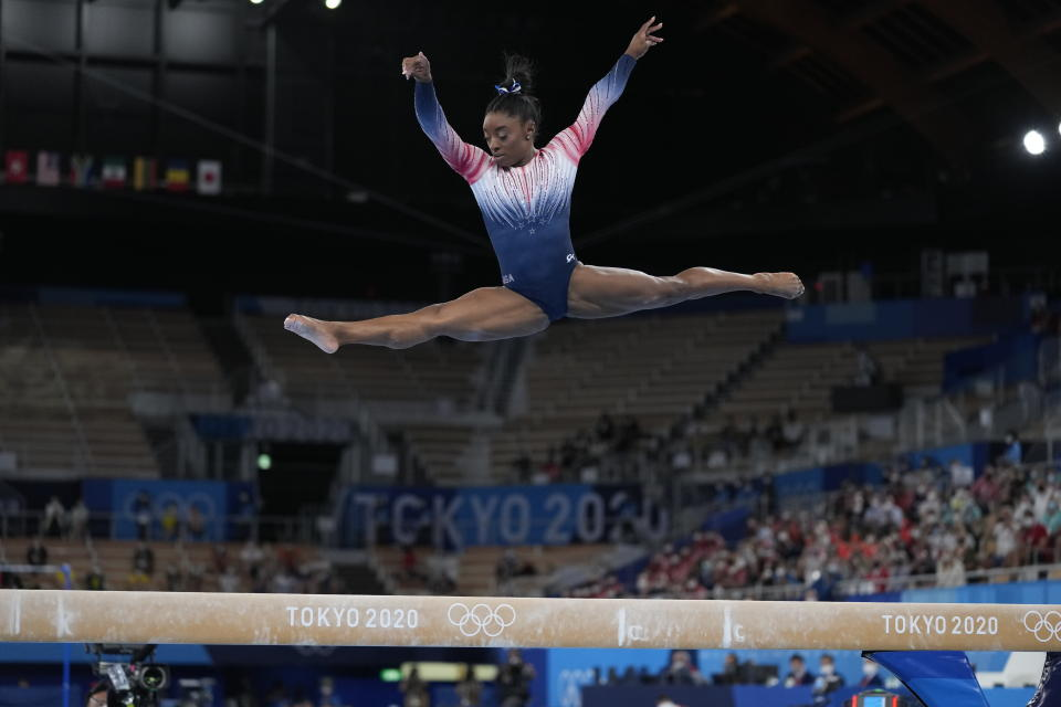 Simone Biles, of the United States, performs on the balance beam during the artistic gymnastics women's apparatus final at the 2020 Summer Olympics, Tuesday, Aug. 3, 2021, in Tokyo, Japan. (AP Photo/Ashley Landis)