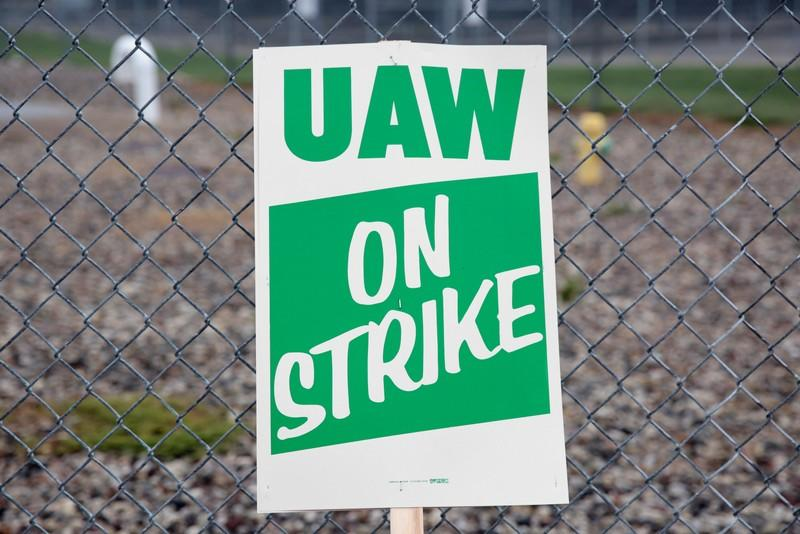 FILE PHOTO: A United Auto Workers (UAW) picket sign is seen outside General Motors Powertrain Flint Engine plant during the UAW national strike in Flint