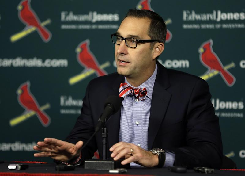 St. Louis Cardinals general manager John Mozeliak speaks during a news conference about the signing of free agent shortstop Jhonny Peralta Monday, Nov. 25, 2013, in St. Louis. The baseball team has announced they have signed Peralta to a four-year contract through the 2017 season. (AP Photo/Jeff Roberson)