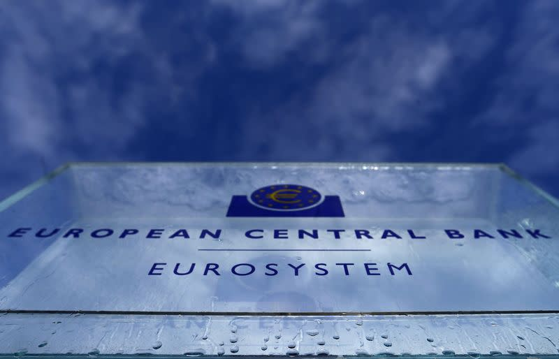 Water droplets from melting ice are seen on the entrance sign of the new European Central Bank (ECB) headquarters in Frankfurt