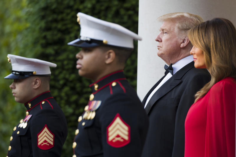 President Donald Trump and first lady Melania Trump await the arrival of Prince Charles, and Camilla, Duchess of Cornwall, before a dinner at the U.S. ambassador's residence, Tuesday, June 4, 2019, in central London. (AP Photo/Alex Brandon)