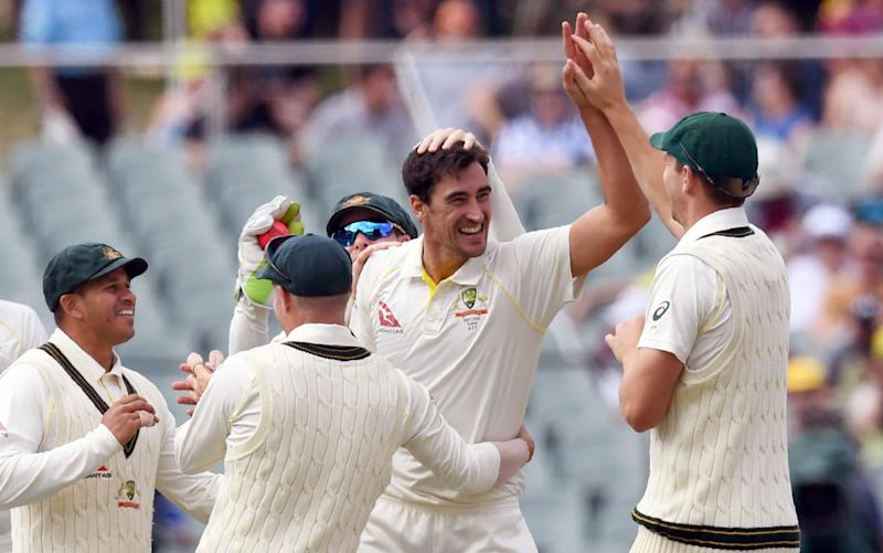 Mitchell Starc celebrates after taking the wicket of England batsman Jonny Bairstow on day three - AFP