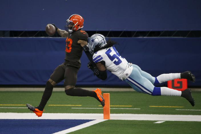 Cleveland Browns wide receiver Odell Beckham Jr. (13) scores a touchdown after a long run as Dallas Cowboys linebacker Jaylon Smith (54) attempts the stop in the second half of an NFL football game in Arlington, Texas, Sunday, Oct. 4, 2020. (AP Photo/Michael Ainsworth)