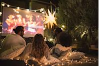 """<p>Level up your standard movie night by setting up a screening — and some cozy seating — right out on your lawn, then picking out an All-American movie that's perfect for the holiday. Don't forget the popcorn!</p><p><strong>RELATED: </strong><a href=""""https://www.goodhousekeeping.com/life/entertainment/g27656502/4th-of-july-movies/"""" rel=""""nofollow noopener"""" target=""""_blank"""" data-ylk=""""slk:The 25 Best Patriotic 4th of July Movies to Watch This Holiday"""" class=""""link rapid-noclick-resp"""">The 25 Best Patriotic 4th of July Movies to Watch This Holiday</a></p>"""