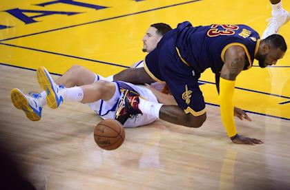 LeBron James' triple-double wasn't enough to save the Cavs from a second straight double-digit Finals defeat. (AFP)