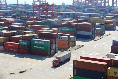 China's April exports rise but slow from March