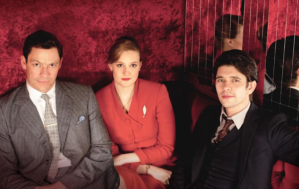 In this photo released by Kudos/BBC taken in March 2012, actors Dominic West, Romola Garai and Ben Whishaw pose for a photograph onset of the BBC programme The Hour (AP Photo/Kudos/BBC)