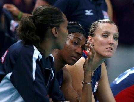 Tayyiba Haneef-Park, Destinee Hooker and Jordan Larson (L-R) of the U.S. react after losing their women's gold medal volleyball match against Brazil at Earls Court during the London 2012 Olympic Games August 11, 2012. REUTERS/Ivan Alvarado/Files