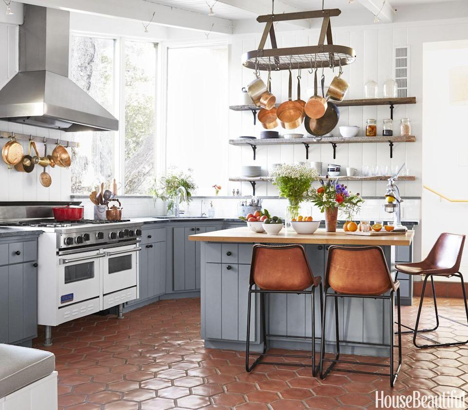 "<p>You don't have to re-do your whole kitchen to make a statement. <a href=""https://www.housebeautiful.com/design-inspiration/house-tours/g3734/frances-merrill-california-house/"" rel=""nofollow noopener"" target=""_blank"" data-ylk=""slk:This kitchen"" class=""link rapid-noclick-resp"">This kitchen</a> by Frances Merrill has existing countertops and white range, but the cabinets were painted and hexagonal terracotta floor tiles were added, as well as open shelves. </p>"
