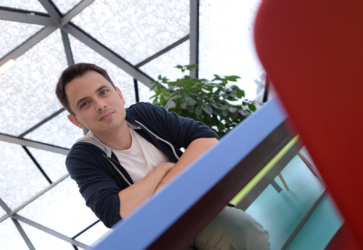 Hungarian Gyula Feher, co-founder of Ustream, poses for a photo at the company's headquarters in Budapest on August 26, 2014 (AFP Photo/Attila Kisbendek)