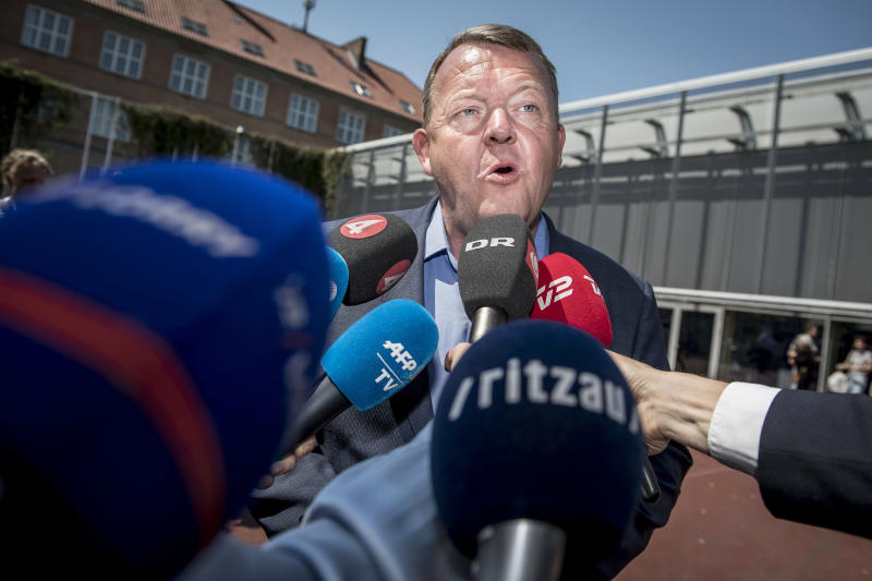 Danish Prime Minister Lars Loekke Rasmussen from the Liberal Party faces the media after casting his vote in Copenhagen, Denmark, Wednesday June 5, 2019, during parliamentary elections. (Mads Claus Rasmussen / Ritzau Scanpix via AP)