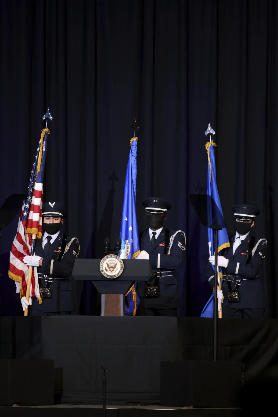 Members of the 88th Air Base Wing Honor Guard from Wright-Patterson Air Force Base in in Ohio post the colors during a memorial service for the late Air Force Brig. Gen. Chuck Yeager in Charleston, W.Va., on Friday, Jan. 15, 2021. Yeager died last month at age 97. The West Virginia native in 1947 became the first person to fly faster than sound. (AP Photo/Chris Jackson)