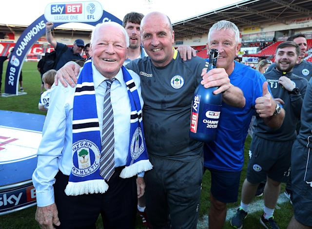 "Soccer Football - League One - Doncaster Rovers vs Wigan Athletic - Keepmoat Stadium, Doncaster, Britain - May 5, 2018 Wigan Athletic owner Dave Whelan and manager Paul Cook celebrate after winning League One Action Images/John Clifton EDITORIAL USE ONLY. No use with unauthorized audio, video, data, fixture lists, club/league logos or ""live"" services. Online in-match use limited to 75 images, no video emulation. No use in betting, games or single club/league/player publications. Please contact your account representative for further details."