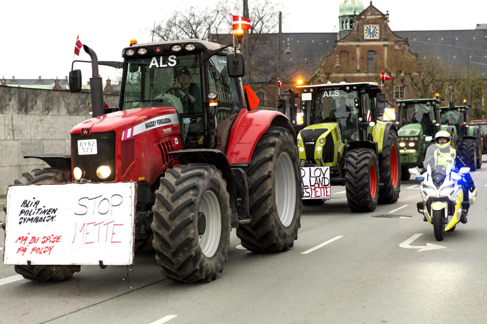 COPENHAGEN, DENMARK - NOVEMBER 21: Danish farmers drive their tractors in a protest demonstration through the capital and past Parliament on November 21, 2020 in Copenhagen, Denmark. Danish farmers accuse the government of breaching the constitution with an order to mass cull minks in Denmark. They also protest against the so-called Epedimic Law, issued in March 2020 which gave the Government unlimited power to fight the Corona thread, and which was used in the mink case. The Danish minority Government has presented a new Epidemic Law for the Parliament which, the organizers claims, provides for unconstitutional decisions and to deploy the army to assist the authorities in carrying through illegal decisions, the organizer, folkelighed.dk, states on their website. The farmers participated with some 500 tractors. (Photo by Ole Jensen/Getty Images)