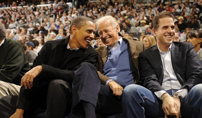 Then-president Barack Obama with vice-president Joe Biden and Hunter Biden at a college basketball game in 2010. Photo: AFP