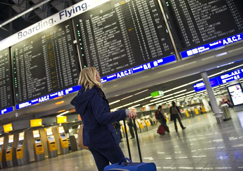 A woman looks at an information board which displays canceled flights at the airport in Frankfurt, Germany, Tuesday March 12, 2013. Due to heavy snowfalls the airport was closed temporarily. (AP Photo/dpa,Nicolas Armer)