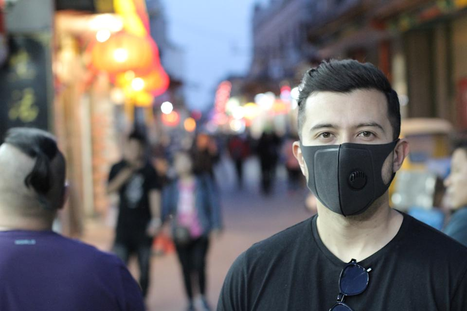 Urban picture of young man with pollution mask.