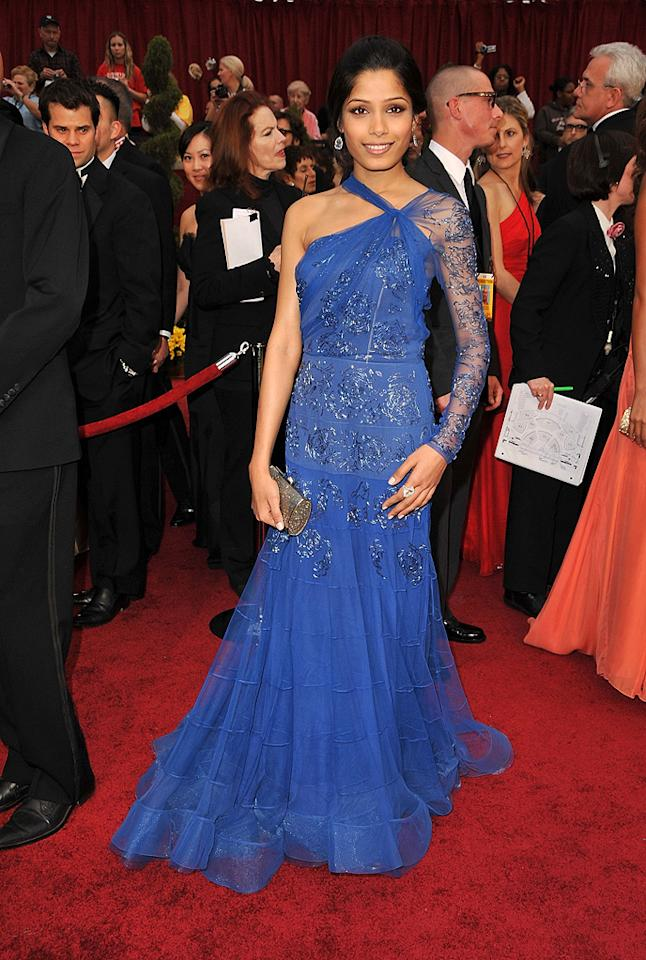 Freida Pinto   Grade: C-       Hollywood's hottest commodity dropped the ball in a royal blue one-sleeved eyesore courtesy of John Galliano.