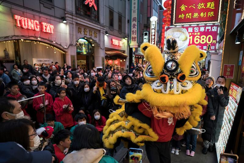YOKOHAMA, JAPAN - JANUARY 25: A lion dance is performed in Yokohama China Town on January 25, 2020 in Yokohama, Japan. Thousands of people gathered in the largest Chinese community in Japan to celebrate the Chinese Lunar New Year of the Rat. (Photo by Tomohiro Ohsumi/Getty Images)