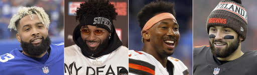 FILE - These are 2018 file photos showing, from left, New York Giants wide receiver Odell Beckham, Cleveland Browns wide receiver Jarvis Landry, Browns defensive end Myles Garrett and Browns quarterback Baker Mayfield. One of the architects of Kansas Citys turnaround, Cleveland Browns general manager John Dorsey has revamped a Cleveland roster that now includes Beckham, Landry, Garrett and Mayfield. (AP Photo/File)