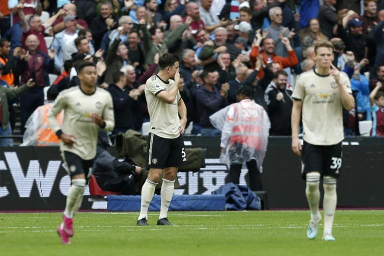Manchester United's players were dejected after their 2-0 defeat to West Ham (AFP Photo/Ian KINGTON)