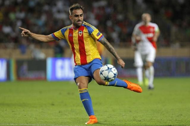 Valencia's forward Paco Alcacer kicks the ball during the UEFA Champions League playoff football match between AS Monaco FC vs Valencia CF, at the Louis II Stadium, in Monaco, on August 25, 2015